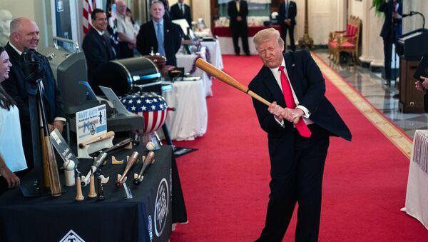 President Donald Trump swings a baseball bat during the Spirit of America Showcase at the White House, Thursday, July 2, 2020, in Washington - Sputnik International