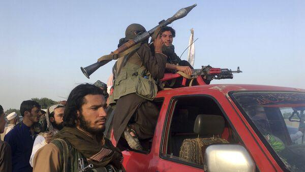 Taliban fighters ride in their vehicle in Surkhroad district of Nangarhar province, east of Kabul, Afghanistan, Saturday, June 16, 2018 - Sputnik International