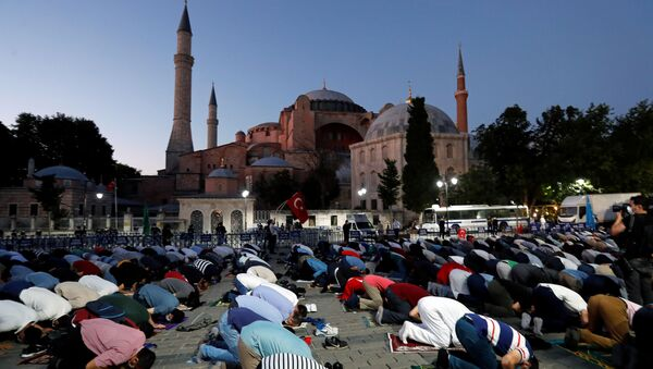 Muslims gather for evening prayers in front of the Hagia Sophia or Ayasofya, after a court decision that paves the way for it to be converted from a museum back into a mosque, in Istanbul, Turkey, July 10, 2020 - Sputnik International