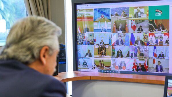Handout photo released by Argentina's Presidency showing Argentine President Alberto Fernandez talking during the G20's video conference meeting at the Olivos Presidential residence in Buenos Aires outskirts, on March 26, 2020 - Sputnik International
