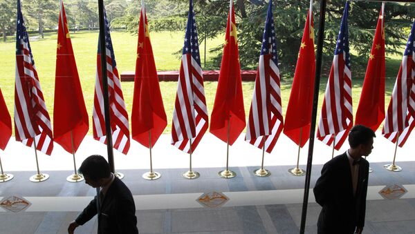 Chinese and US national flags are posted for the opening ceremony of the U.S.- China Strategic and Economic Dialogue at The Diaoyutai state guesthouse in Beijing Thursday, May 3, 2012 - Sputnik International