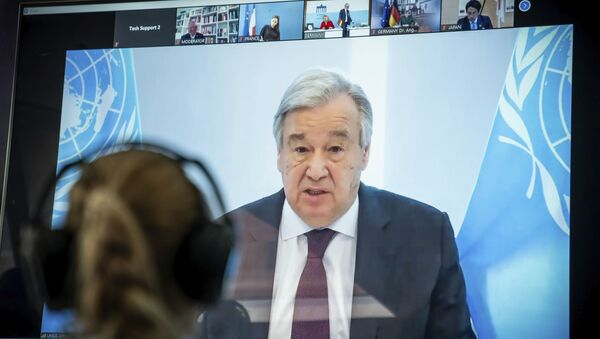 Antonio Guterres, UN Secretary-General displayed on a screen at the  Environment Ministry as he delivers his speech at the Petersberg Climate Dialogue, in Berlin, Germany, Tuesday, April 28, 2020. - Sputnik International