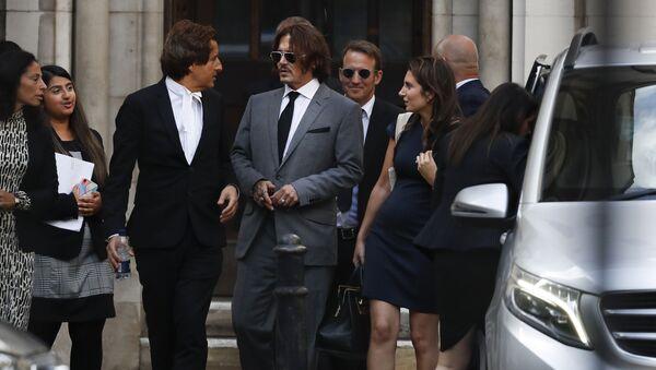 Actor Johnny Depp, centre, leaves the High Court in London, Monday, 13 July 2020 - Sputnik International