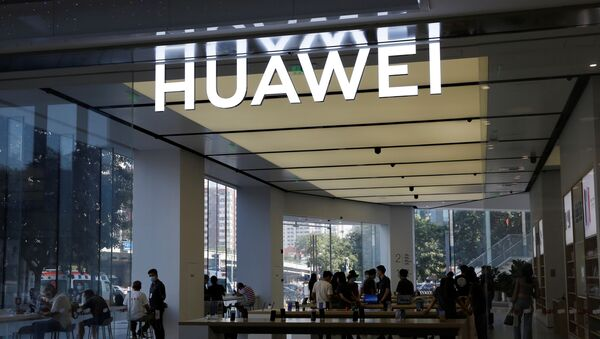 People are seen inside a Huawei store at a shopping mall in Beijing, China July 14, 2020 - Sputnik International