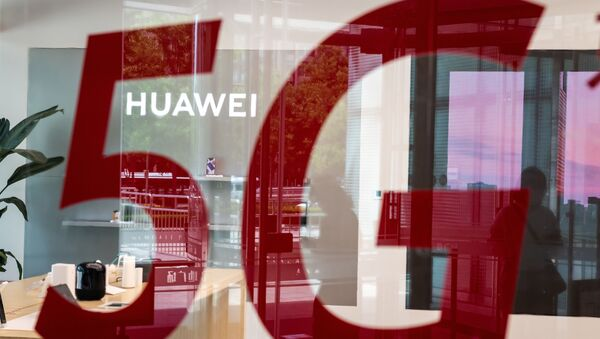 (FILES) This file photo taken on May 25, 2020, shop for Chinese telecom giant Huawei features a red sticker reading 5G in Beijing on May 25, 2020 - Sputnik International