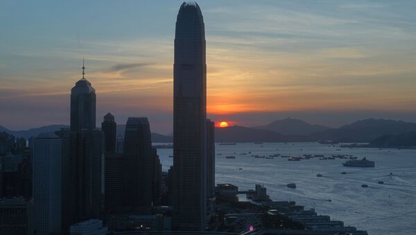 The skyline of the business district is silhouetted at sunset in Hong Kong Monday, July 13, 2020 - Sputnik International