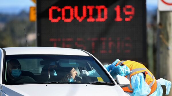 A member of the public is seen getting a test for the coronavirus disease (COVID-19) at the Crossroads Hotel testing centre following a cluster of infections in Sydney, Australia, July 16, 2020 - Sputnik International