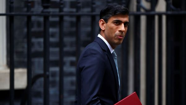 Britain's Chancellor of the Exchequer Rishi Sunak reacts as he leaves Downing Street, in London, Britain July 8, 2020. - Sputnik International