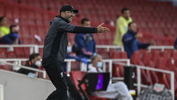 Liverpool's manager Jurgen Klopp gestures during the English Premier League soccer match between Arsenal and Liverpool at the Emirates Stadium in London, England, Wednesday, July 15, 2020. - Sputnik International