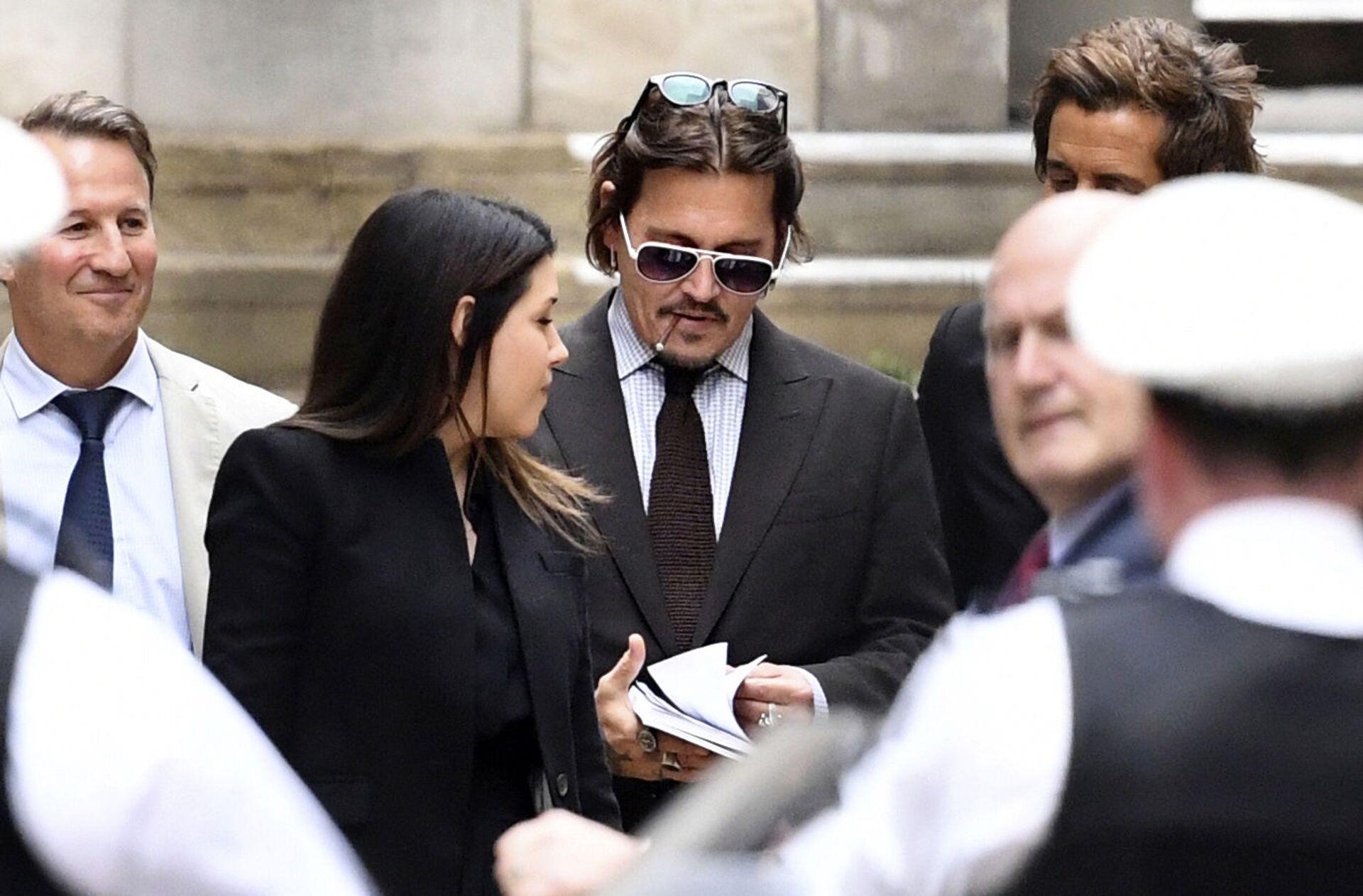 Actor Johnny Depp leaves the High Court in London, Wednesday July 15, 2020 - Sputnik International, 1920, 07.09.2021