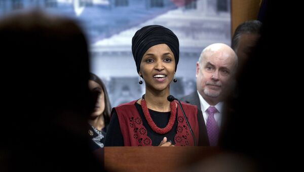 Congressional Progressive Caucus members Rep. Ilhan Omar, D-Minn., accompanied by Rep. Mark Pocan, D-Wis., and other members of the Caucus, speaks during a news conference on last week's targeted killing of Iran's senior military commander Gen. Qassem Soleimani on Capitol Hill, in Washington, Wednesday, Jan. 8, 2020. - Sputnik International