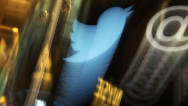 In this Wednesday Nov. 6, 2013, file photo, the Twitter logo appears on an updated phone post on the floor of the New York Stock Exchange - Sputnik International