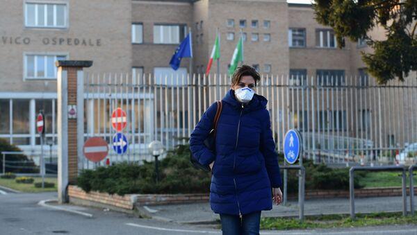 A nurse wearing a protective respiratory mask leaves the municipal hospital in Codogno, southeast of Milan, on February 22, 2020. - Sputnik International