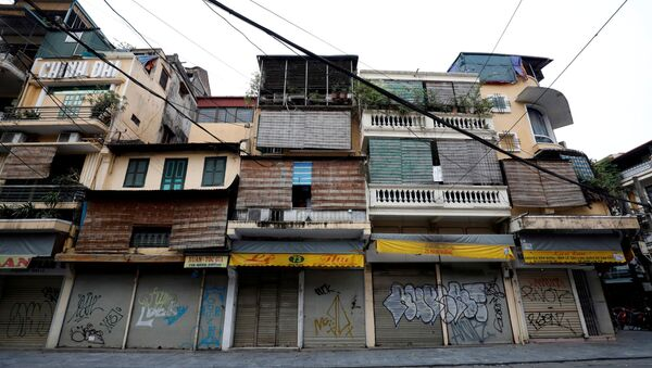 Closed shops are seen on an empty Hang Duong street which was previously one of the most busy streets during the coronavirus disease (COVID-19) outbreak in Hanoi, Vietnam - Sputnik International