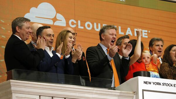 In this Sept. 13, 2019, file photo, Cloudflare co-founder and CEO Matthew Prince, right center, applauds during New York Stock Exchange opening bell ceremonies to celebrate his company's IPO. San Francisco-based Cloudflare said Wednesday, Jan. 15, 2020, it will provide free cybersecurity support to federal election campaigns. - Sputnik International