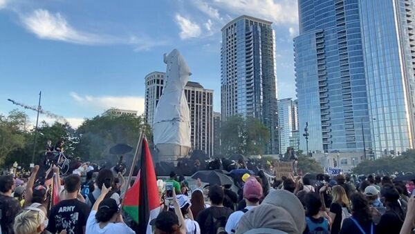 Protesters surround a statue of Christopher Columbus at Grant Park in Chicago, Illinois, U.S., July 17, 2020, in this still image from video obtained via social media - Sputnik International