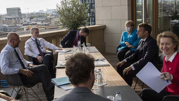 European Council President Charles Michel (L), German Chancellor Angela Merkel (3rd R), French President Emmanuel Macron (2nd R), and European Commission President Ursula von der Leyen (R) meet on the sidelines of an EU summit on a coronavirus recovery package at the European Council building in Brussels on July 18, 2020 - Sputnik International