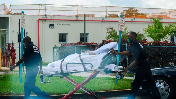 Emergency Medical Technicians (EMT) leave with a patient at North Shore Medical Center where the coronavirus disease (COVID-19) patients are treated, in Miami, Florida, U.S. July 14, 2020. - Sputnik International