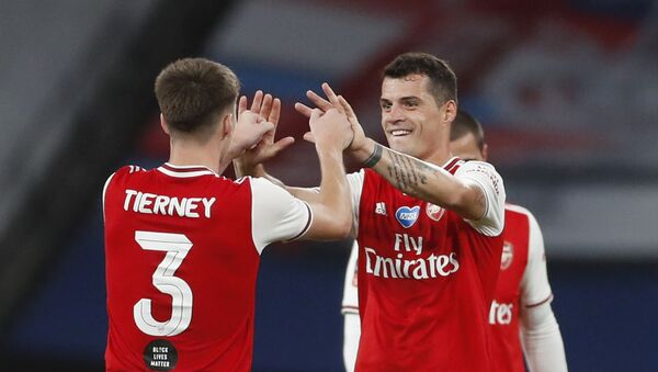 Soccer Football - FA Cup Semi Final - Arsenal v Manchester City - Wembley Stadium, London, Britain - July 18, 2020 Arsenal's Granit Xhaka and Kieran Tierney celebrate after the match, as play resumes behind closed doors following the outbreak of the coronavirus disease (COVID-19) - Sputnik International