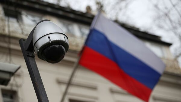A security camera is seen, and a flag flies outside the consular section of Russia's embassy in London, Britain, March 15, 2018.  - Sputnik International