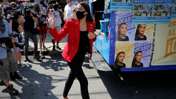 U.S. Rep. Alexandria Ocasio-Cortez (D-NY) waves as she makes a stop to greet voters during the Democratic congressional primary election in the Queens borough of New York City, New York, U.S., June 23, 2020 - Sputnik International
