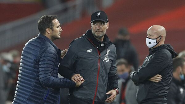Soccer Football - Premier League - Liverpool v Chelsea - Anfield, Liverpool, Britain - July 22, 2020 Liverpool manager Juergen Klopp shakes hands with Chelsea manager Frank Lampard after the match, as play resumes behind closed doors following the outbreak of the coronavirus disease (COVID-19) - Sputnik International