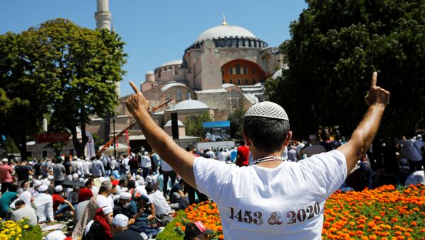 A man gestures as people wait for the beginning of Friday prayers outside Hagia Sophia Grand Mosque, for the first time after it was once again declared a mosque after 86 years, in Istanbul, Turkey, July 24, 2020 - Sputnik International