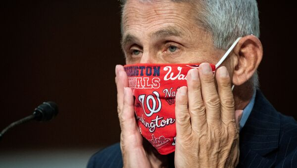 Anthony Fauci, director of the National Institute of Allergy and Infectious Diseases, adjusts his face mask during a Senate Health, Education, Labor and Pensions Committee hearing on efforts to get back to work and school during the coronavirus disease (COVID-19) outbreak, in Washington, D.C., U.S. June 30, 2020 - Sputnik International