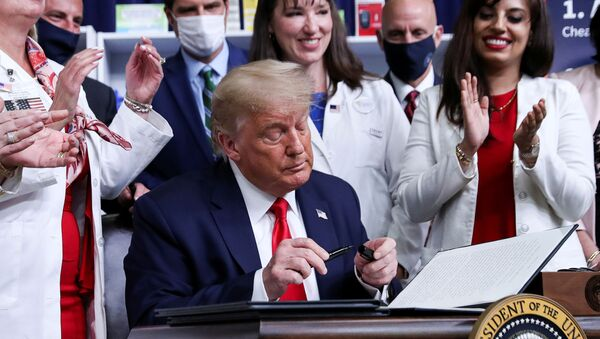 U.S. President Donald Trump signs an executive order on lowering drug prices during a ceremony in the Eisenhower Executive Office Building at the White House in Washington, U.S., July 24, 2020. - Sputnik International