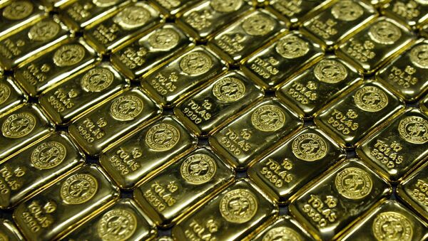 Gold bars are displayed at South Africa's Rand Refinery in Germiston in May 30, 2006.  - Sputnik International