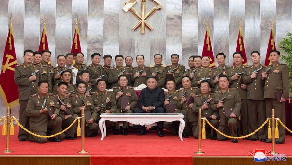 North Korean leader Kim Jong Un poses for a photograph after conferring Paektusan commemorative pistols to leading commanding officers of the armed forces on the 67th anniversary of the Day of Victory in the Great Fatherland Liberation War, which marks the signing of the Korean War armistice, in this undated photo released on July 27, 2020 by North Korean Central News Agency (KCNA) in Pyongyang - Sputnik International