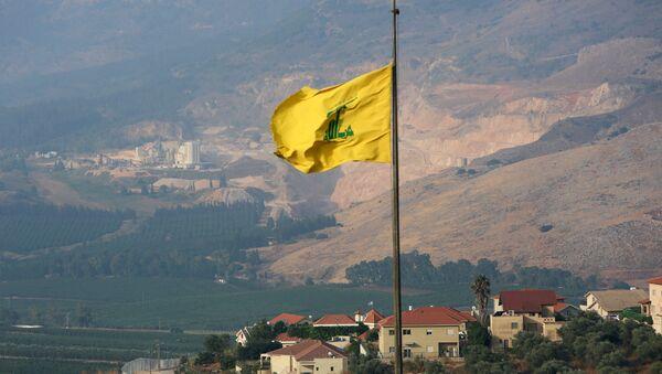A Hezbollah flag flutters in the southern Lebanese village of Khiam, near the border with Israel, Lebanon July 28, 2020 - Sputnik International