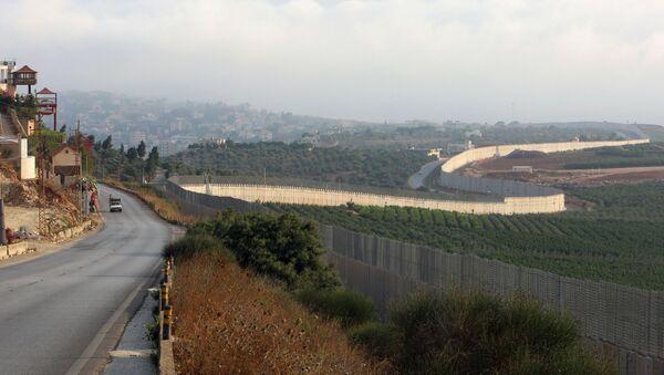 A vehicle drives in the southern Lebanese village of Kfar Kila, near the border with Israel, Lebanon July 28, 2020. - Sputnik International