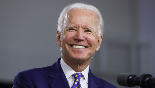 Democratic presidential candidate and former Vice President Joe Biden smiles during an event to announce his plans to combat racial inequality in Wilmington, Delaware, U.S., July 28, 2020. - Sputnik International