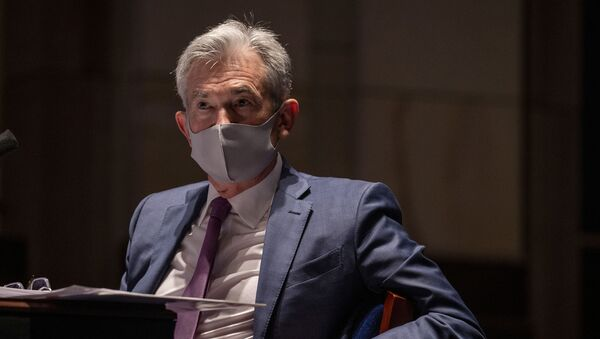 Federal Reserve Chairman Jerome Powell, wearing a face mask, testifies before the House of Representatives Financial Services Committee during a hearing on oversight of the Treasury Department and Federal Reserve response to the outbreak of the coronavirus disease (COVID-19), on Capitol Hill in Washington, U.S., June 30, 2020. - Sputnik International