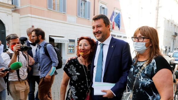 Leader of Italy's League party Matteo Salvini poses with supporters before addressing the upper house of parliament ahead of a vote by senators on whether to allow magistrates to investigate him for refusing a migrant rescue boat permission to land last year when he was interior minister, in Rome, Italy, July 30, 2020.  - Sputnik International