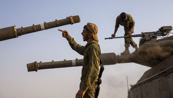 Israeli soldiers work on tanks in the Israeli controlled Golan Heights near the border with Syria, not far from Lebanon border, Tuesday, July 28, 2020.  - Sputnik International