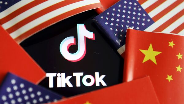 China and U.S. flags are seen near a TikTok logo in this illustration picture taken July 16, 2020 - Sputnik International