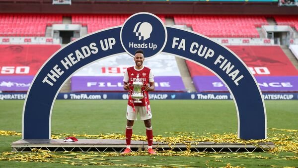 FA Cup Final - Arsenal v Chelsea - Wembley Stadium, London, Britain - August 1, 2020 Arsenal's Pierre-Emerick Aubameyang celebrates with the trophy after winning the FA Cup, as play resumes behind closed doors following the outbreak of the coronavirus disease (COVID-19)  - Sputnik International