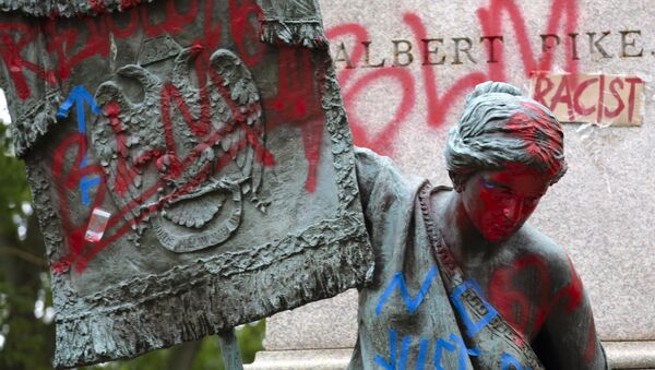 The bronze sculpture representing the Goddess of Masonry on the base of the statue of a Confederate general, Albert Pike, is seen with red paint, after protestors toppled Pike statue's and set on fire early Saturday, June 20, 2020, in Washington. It comes on Juneteenth, the day marking the end of slavery in the United States, amid continuing anti-racism demonstrations following the death of George Floyd in Minneapolis - Sputnik International