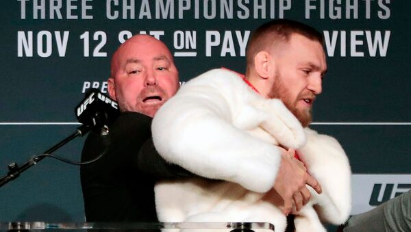 In this Nov. 10, 2016, file photo, fighter Conor McGregor, right, is restrained by UFC president Dana White during a news conference ahead of the UFC 205 mixed martial arts fight between McGregor and Eddie Alvarez, not shown, at Madison Square Garden in New York. - Sputnik International
