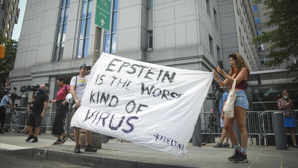 Multimedia artist Katelyn Kopenhaver, right, with help from her brother Brent Kopenhaver, unfurls a banner reading [Jefferey] Epstein is the worst kind of virus, outside federal court where a judge held a bail hearing by video for Epstein's former girlfriend Ghislaine Maxwell, Tuesday, July 14, 2020, in New York. - Sputnik International