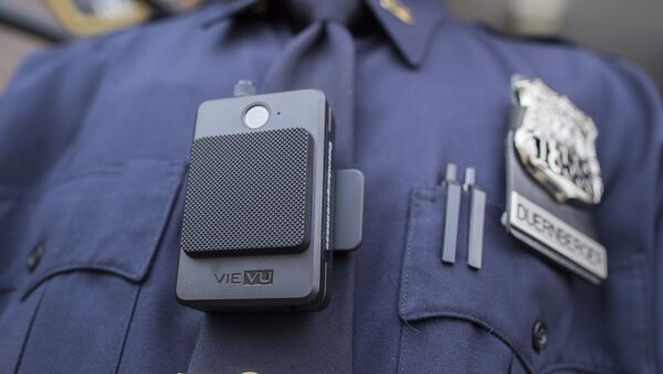 A police officer wears a newly issued body camera outside the 34th precinct, Thursday, April 27, 2017, in New York. The New York Police Department is launching the first phase of a plan to equip 22,000 officers with body cameras - Sputnik International
