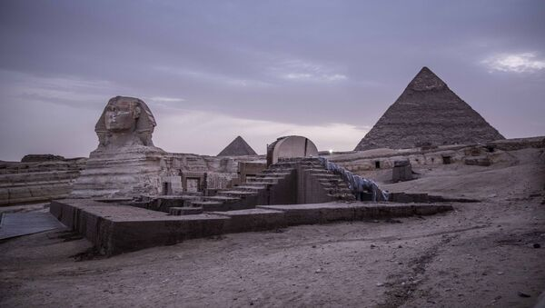 This March 30, 2020 file photo, shows the empty Giza Pyramids and Sphinx complex on lockdown due to the coronavirus outbreak in Egypt. In July, fearing further economic fallout, the government reopened much of society and welcomed hundreds of international tourists back to resorts, even as daily reported deaths exceeded 80. Restaurants and cafes are reopening with some continued restrictions, and masks have been mandated in public - Sputnik International