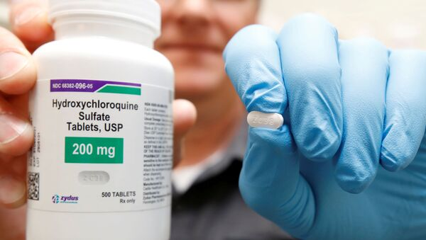 The drug hydroxychloroquine, pushed by U.S. President Donald Trump and others in recent months as a possible treatment for people infected with the coronavirus disease (COVID-19), is displayed by a pharmacist at the Rock Canyon Pharmacy in Provo, Utah, U.S., May 27, 2020.  - Sputnik International
