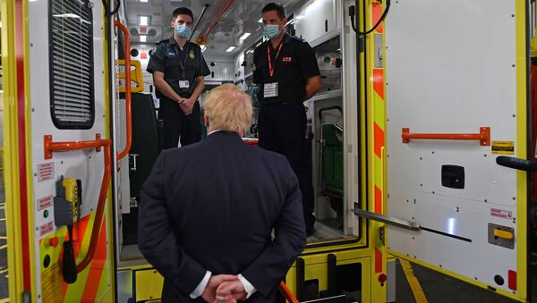 Britain's Prime Minister Boris Johnson talks with a paramedic Jack Binder and firefighter Tom Binder as he visits headquarters of the London Ambulance Service NHS Trust, amid the spread of the coronavirus disease (COVID-19), in London, Britain July 13, 2020.  - Sputnik International