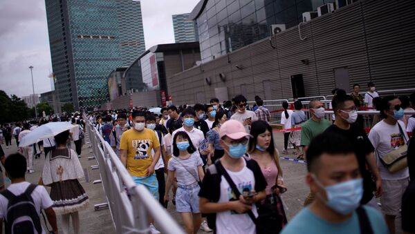 People arrive to attend the China Digital Entertainment Expo and Conference (ChinaJoy) in Shanghai, following the coronavirus disease (COVID-19) outbreak, China July 31, 2020.  - Sputnik International