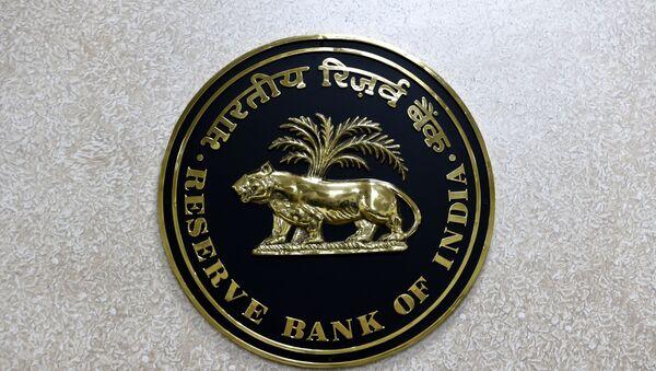 The Reserve Bank of India (RBI) logo is displayed on a wall inside the Reserve Bank of India in New Delhi on July 8, 2019. - Sputnik International