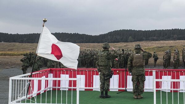 Japan Ground Self-Defense Force Col. Hiroji Yamashita, left, and U.S. Marine Maj. Roy M. Draa salute their troops Dec. 1 during the opening ceremony for Forest Light 15-1 at the Oyanohara Training Area in Yamato, Kumamoto prefecture, Japan. Forest Light is a semi-annual, bilateral exercise consisting of a command post exercise and field training event conducted by elements of III Marine Expeditionary Force and the JGSDF. Yamashita is the commanding officer with 42nd Regiment, 8th Division, Western Army, JGSDF. Draa, from Baltimore, Maryland, and is the executive officer with 2nd Battalion, 9th Marine Regiment, currently attached to 4th Marine Regiment, 3rd Marine Division, III MEF, under the unit deployment program - Sputnik International