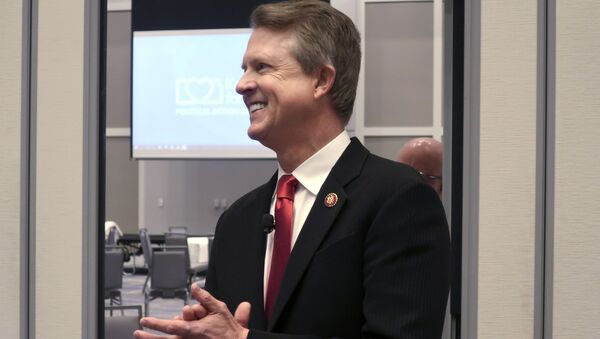 In this Feb. 1, 2020 file photo, U.S. Rep. Roger Marshall, R-Kan., a candidate for the U.S. Senate, awaits the start of a debate in Olathe, Kansas,Establishment Republicans worried heading into Kansas' primary Tuesday, Aug. 4, 2020 for an open Senate that weeks of effort to thwart polarizing conservative Kris Kobach would falter because they couldn't persuade President Donald Trump to endorse their favored candidate. - Sputnik International